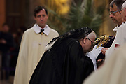 Crown of Thorns held on a cushion, at the Veneration of the Crown of Thorns, or Veneration de la Sainte Couronne d'Epines, on Friday 29th March 2019, by the Ordre des Chevaliers du Saint Sepulcre, or the Order of the Knights of the Holy Sepulcher of Jerusalem, guardians of the relics of Christ's Passion since 1920, in the Cathedrale Notre-Dame de Paris, or Notre-Dame cathedral, built 1163-1345 in French Gothic style, on the Ile de la Cite in the 4th arrondissement of Paris, France. The crown of thorns has been held in Paris since 1239 and at Notre-Dame since 1806, along with a piece of the true cross and a nail from the crucifixion. The crown is held in a tubular reliquary of crystal and gold, with a perforated frame depicting a branch of zizyphus or Spina Christi, made by silversmith M Poussielgue-Rusand, 1861-1933, after drawings by J-G Astruc, 1862-1950. The veneration ceremony usually takes place on the first Friday of each month, every Friday of Lent, and on Good Friday. Picture by Manuel Cohen