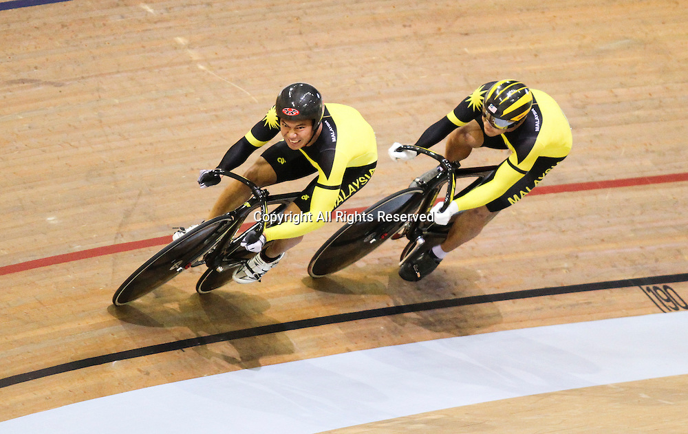 24.07.2014. Glasgow, Scotland. Glasgow Commonwealth Games. Mens Team Sprint Qualifying from the Sir Chris Hoy Velodrome. The Malaysian cyclists take to the track