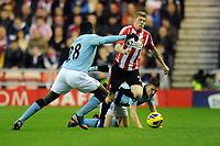 Football - 2012 / 2013 Premier League - Sunderland vs. Manchester City<br /> James McClean (Sunderland) battles his way through the Manchester players at the Stadium of Light