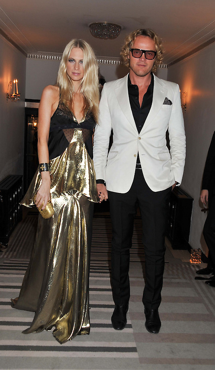 POPPY DELEVINGNE and PETER DUNDAS at the Harper's Bazaar Women of the Year Awards 2011 held at Claridge's, Brook Street, London on 7th November 2011.