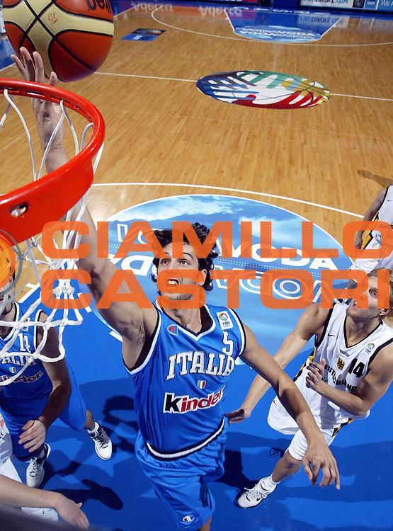 DESCRIZIONE : Vrsac Eurobasket Men 2005 Italia-Germania<br /> GIOCATORE : Basile<br /> SQUADRA : Italia Italy<br /> EVENTO : Eurobasket Men 2005 Campionati Europei Uomini 2005<br /> GARA : Italia Germania Italy Germany<br /> DATA : 16/09/2005<br /> CATEGORIA :<br /> SPORT : Pallacanestro<br /> AUTORE : Ciamillo&amp;Castoria/Fiba Europe Pool