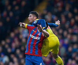 LONDON, ENGLAND - Saturday, February 21, 2015: Arsenal's Oliver Giroud in action against Crystal Palace's captain Scott Dann during the Premier League match at Selhurst Park. (Pic by David Rawcliffe/Propaganda)
