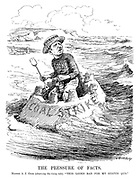 "The Pressure of Facts. Master A J Cook (observing the rising tide). ""This looks bad for my status quo."" (cartoon showing leader of the Miners' Federation Arthur James Cook on a Coal Strike sand castle with a Victory hat amid the coming waves at the seaside during the InterWar era)"