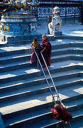 NEPAL KATHMANDU APR95 - Buddhist novices play on the stairs leading up to the Shwayambunath Temple in western Kathmandu. The Shwayambunath temple is one of the three major religious sites in Nepal. <br />