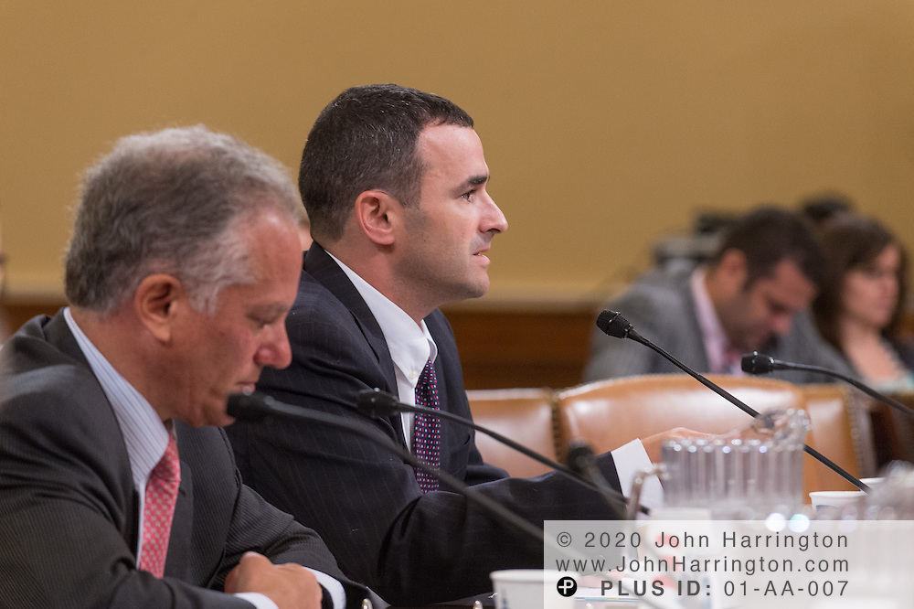 "Daniel Werfel, Principal Deputy Commissioner for Services and Enforcement at the Internal Revenue Service (right) testifies as Gary Cohen, Deputy Administrator and Director, Consumer Information and Insurance Oversight at the U.S. Department of Health and Human Services (left) looks on during the House Committee on Ways and Means hearing on ""The Status of the Affordable Care Act Implementation"" on Capitol Hill in Washington, DC August 1, 2013."