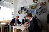 "Zagreb, Croatia- May 5, 2015: Patrons enjoy lunch at Lari & Penati, a bistro opened in 2011 just off the Green Horseshoe, a U-shaped series of parks that strectch around Lower Town in Zagreb. The bistro specializes in traditional Croatian with a ""street food"" feel. CREDIT: Chris Carmichael for The New York Times"