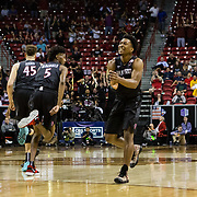 09 March 2018: San Diego State men's basketball takes on Nevada in the quarterfinal round of the Mountain West Conference Tournament. San Diego State Aztecs guard Devin Watson (0) celebrates after making a basket and extending the Aztecs lead in the first half. The Aztecs cruise past the Wolfpack 90-73 to move on to the Championship game tomorrow afternoon at 3pm.<br /> More game action at www.sdsuaztecphotos.com