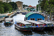 14 NOVEMBER 2012 - BANGKOK, THAILAND: Khlong boats at the Wat Sriboonreung Pier, the southern terminal of the Khlong Saen Saeb boat service. Bangkok used to be criss crossed by canals (called Khlongs in Thai) but most have been filled in and paved over. Khlong Saen Saeb is one of the few remaining khlongs in Bangkok with regular passenger boat service. Boats and ships play an important in daily life in Bangkok. Thousands of people commute to work daily on the Chao Phraya Express Boats and fast boats that ply Khlong Saen Saeb. Boats are used to haul commodities through the city to deep water ports for export.      PHOTO BY JACK KURTZ