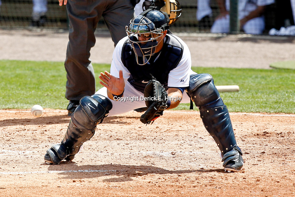 March 14, 2012; Lakeland, FL, USA; Detroit Tigers catcher Alex Avila (13) against the New York Mets during a spring training game at Joker Marchant Stadium. Mandatory Credit: Derick E. Hingle-US PRESSWIRE