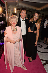 Left to right, GLORIA HUNNIFORD and singers SIR CLIFF RICHARD and MEL C at the annual PINKTOBER Gala presented by Hard Rock Heals at The Dorchester, Park Lane, London on 14th October 2016.  The annual event raises money for The Caron Keating Foundation.