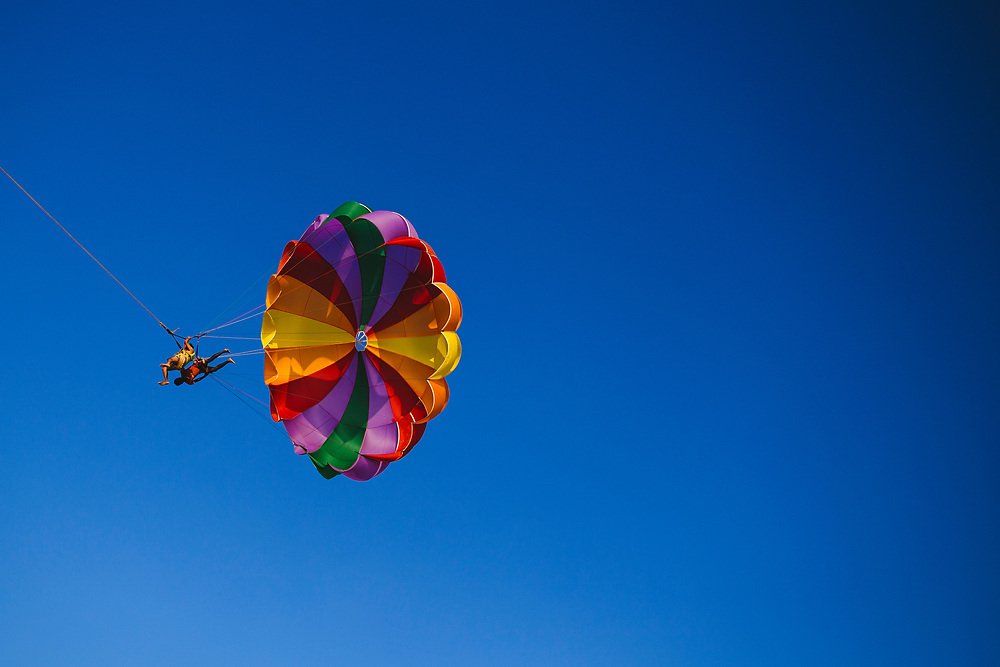 Parachuting at the beach on a clear sunny day in southern Goa, India.