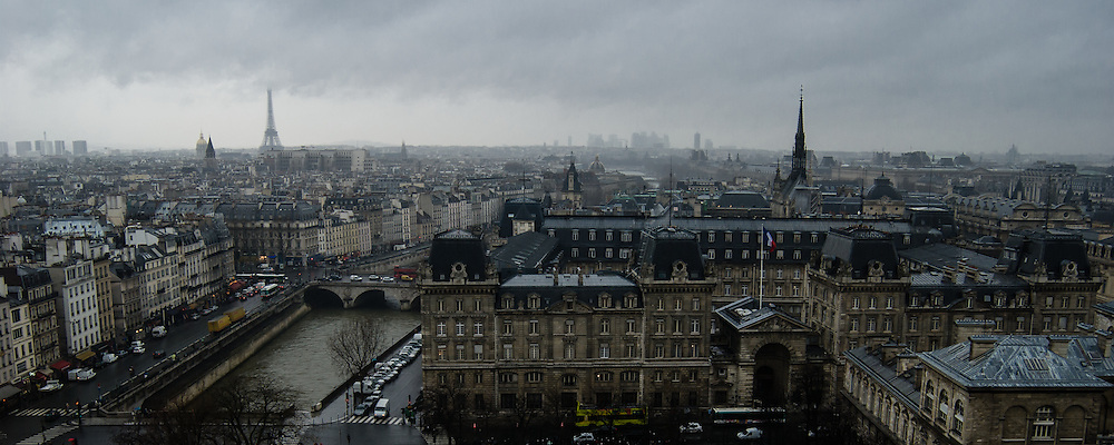 A cloudy day makes a moody scene from atop Notre Dome in Paris, France.