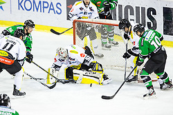 22.02.2015, Hala Tivoli, Ljubljana, SLO, EBEL, HDD Telemach Olimpija Ljubljana vs Dornbirner EC, 6. Qualification Round, in picture Ales Music (HDD Telemach Olimpija, #16) and Tom Zanoski (HDD Telemach Olimpija, #10) vs Nathan Lawson (Dornbirner EC, #52) during the Erste Bank Icehockey League 6. Qualification Round between HDD Telemach Olimpija Ljubljana and Dornbirner EC at the Hala Tivoli, Ljubljana, Slovenia on 2015/02/22. Photo by Matic Klansek Velej / Sportida