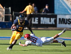 October 24, 2009; Berkeley, CA, USA;  California Golden Bears wide receiver Jeremy Ross (3) breaks a tackle from Washington State Cougars wide receiver Easton Johnson (81) on a kick return during the third quarter at Memorial Stadium.
