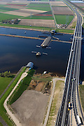 Nederland, Flevoland-Overijssel, Ramspol, 01-05-2013; nieuwe Ramspolbrug in de N50 met naast de brug de balgstuw. De vaargeul in het Ramsdiep met strekdam. <br /> Ramspol, inflatable dike, between Ketelmeer and Black Water. The Balgstuw (bellow barrier) is a storm barrier and consists of an inflatable dam or dyke, composed of three bellows. Usually, each bellow rests on the bottom of the water, but now the bellows are inflated  because of maintenance. luchtfoto (toeslag op standard tarieven)<br /> aerial photo (additional fee required)<br /> copyright foto/photo Siebe Swart