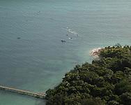 Quicksilver Ocean Swim Held At Green Island Just Off The Cairns Coast During The 2013 Ironman Cairns Triathlon Festival. Green Island, Cairns, Queensland, Australia. 06/06/2013. Photo By Lucas Wroe