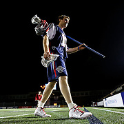 Brodie Merrill #17 of the Boston Cannons walks off of the field following the game at Harvard Stadium on May 10, 2014 in Boston, Massachusetts. (Photo by Elan Kawesch)