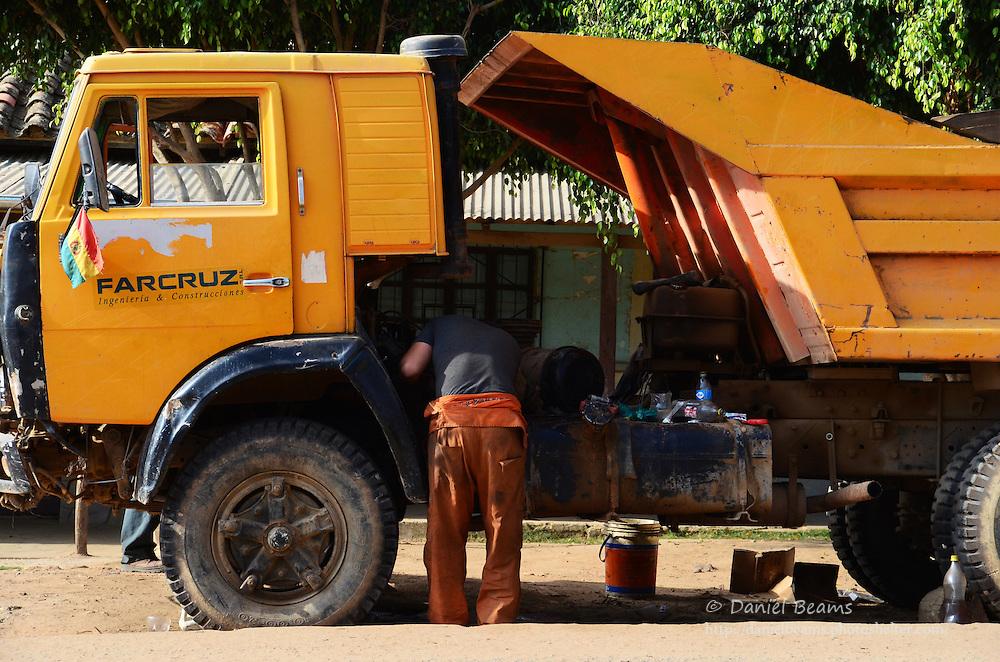 Repairing a dump truck in Samaipata, Bolivia