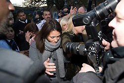 ©  London News Pictures.  20/12/2013. London, UK. Italian Sisters Elisabetta (centre in grey jacket) and Francesca (left in black) Grillo, leaving Isleworth Crown Court in London after being found not guilty of misappropriating funds while working as personal assistants for Charles Saatchi and Nigella Lawson. Photo credit : Ben Cawthra/LNP