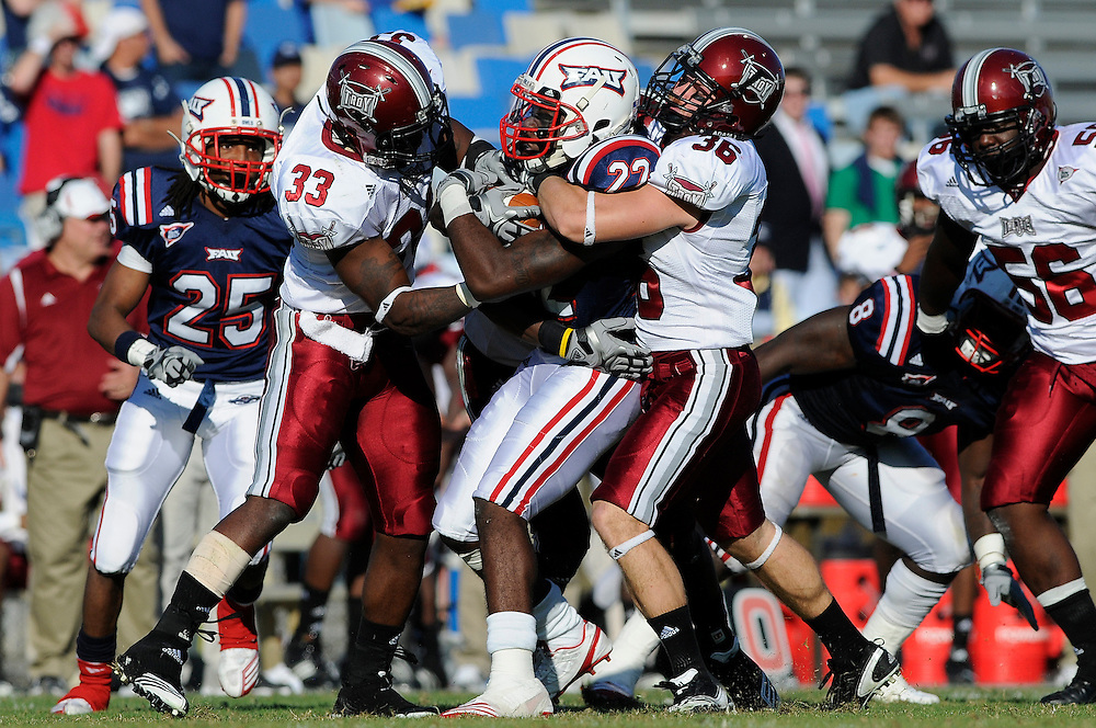 December 4, 2010: Johnny Thompson and Sam Sellers of the Troy Trojans tackles Travis Jones of the Florida Atlantic Owls during the NCAA football game between Troy and FAU. The Trojans defeated the Owls 44-7.