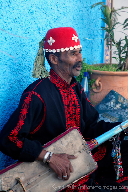 Africa, Morocco, Rabat. Musician of traditional Morcan music, in the Kasbah Oudaya, the old city of Rabat.