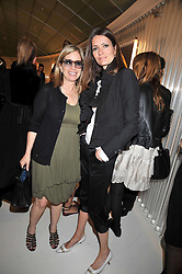 Left to right, RONNIE NEWHOUSE and PLUM SYKES at a dinner in honour of design label Rodarte held at the Fifth Floor Restaurant, Harvey Nichols, Knightsbridge, London on 3rd June 2009.