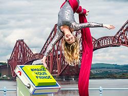 EMBARGOED TILL 10:00 5 JUNE 2019<br /> <br /> Pictured: Fringe Programme Launch. Forth Rail Bridge, South Queensferry, Scotland, United Kingdom, 04 June 2019.<br /> <br /> An aerial artist, Blaise Donald, wearing a sparkling costume performs in front of the iconic bridge launching the Edinburgh Festival Fringe programme and this year's Fringe hashtag #MakeYourFringe.<br /> <br /> Sally Anderson   EdinburghElitemedia.co.uk