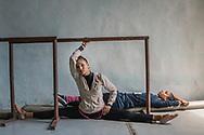 Dancers stretch and rest before a practice session in their ballet academy. Prodanza Ballet Academy, Havana, Cuba. / Dos bailarinas se estiran y descansan antes de ua sesión de práctica. Academia de Ballet Prodanza, La Habana, Cuba