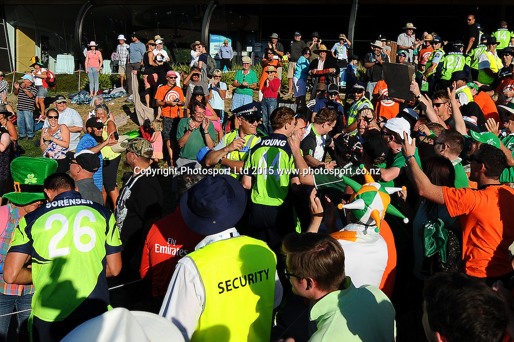Fans cheer as Ireland players make their way back to the dressing room after winning their 2015 ICC Cricket World Cup match between West Indies and Ireland. Saxton Oval, Nelson, New Zealand. Monday 16 February 2015. Copyright Photo: Chris Symes / www.photosport.co.nz