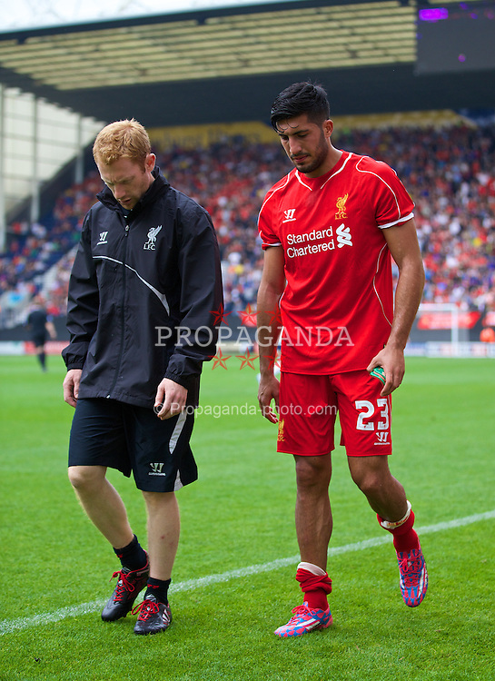 PRESTON, ENGLAND - Saturday, July 19, 2014: Liverpool's Emre Can limps off injured during a preseason friendly match against Preston North End at Deepdale Stadium. (Pic by David Rawcliffe/Propaganda)