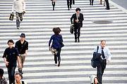 overhead view pedestrians running before traffic light gets red Hachiko square Shibuya Japan Tokyo