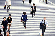overhead view pedestrians running before traffic light gets red Hachiko square Shibuya Japan Tokyo