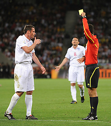 18.01.2010, Green Point Stadium, Cape Town, RSA, FIFA WM 2010, England (ENG) vs Algeria (ALG), im Bild Jamie Carragher of England gets a yellow card by Referee, Ravshan Irmatov. EXPA Pictures © 2010, PhotoCredit: EXPA/ IPS/ Marc Atkins / SPORTIDA PHOTO AGENCY