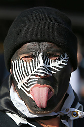 © Licensed to London News Pictures. 31/10/2015. London, UK. A New Zealand rugby fan arrives for the Rugby World Cup final against Australia at Twickenham. Photo credit: Peter Macdiarmid/LNP
