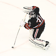 Clay Witt #31 of the Northeastern Huskies clears the puck during The Beanpot Championship Game at TD Garden on February 10, 2014 in Boston, Massachusetts. (Photo by Elan Kawesch)
