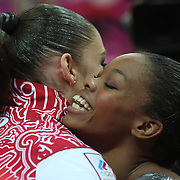 Aliya Mustafina, Russia, (left) is congratulated by  Gabrielle Douglas, USA, after winning the Gold Medal in the Gymnastics Artistic, Women's Apparatus, Uneven Bars Final at the London 2012 Olympic games. London, UK. 6th August 2012. Photo Tim Clayton