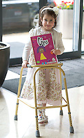 02/06/2014 Ciara Nic Dhonnacha 6 who broke her foot last Friday but made it into Galway to pick up her prize at the 13th annual Write  Book Awards, in the Radisson blu hotel Galway, organised by The Galway Education Centre. The children who ranged in age from just 5 years to 12 years have all composed, written, illustrated and bound their own individual books and their efforts will be recognised at two special awards ceremonies, one in Irish and one in English. Photo:Andrew Downes
