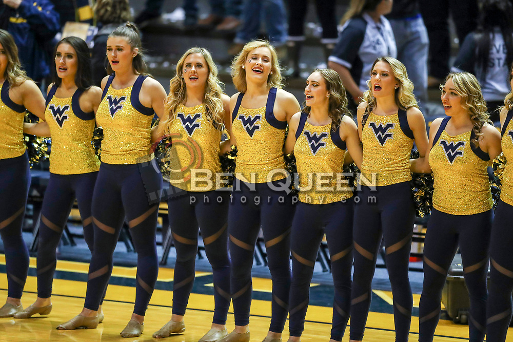 Nov 28, 2018; Morgantown, WV, USA; West Virginia Mountaineers dancers celebrate after beating the Rider Broncs at WVU Coliseum. Mandatory Credit: Ben Queen-USA TODAY Sports