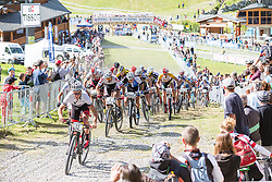 Sam Gaze leads the men's U23 field at the start of the 2014 UCI Mountainbike World Cup at Méribel, France.