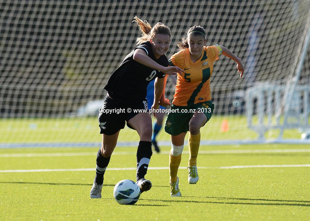 New Zealand's Emily Jensen and Australia's Emma Checker. New Zealand Junior Football Ferns v Australia Young Matildas. Women's U20 International. Match 3. Seddon Fields, Auckland. Monday 29 July 2013. Photo: Andrew Cornaga/www. Photosport.co.nz