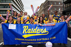 London, June 28th 2014. The London Raiders Softball Club poses for a group shot as Gay Pride revellers assemble on Baker Street ahead of the parade.