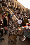 Man serving tea at Khan-alKhalili Bazaar in Cairo, Egypt