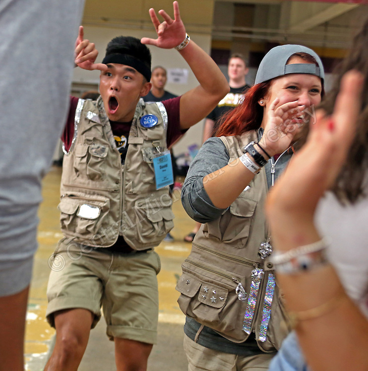 David Wong cheers as safari participants enter Finch Field house photo by Claire Abendroth