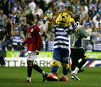 Photo: Chris Ratcliffe.<br />Reading v Manchester United. The Barclays Premiership. 23/09/2006.<br />Cristiano Ronaldo of Manchester United is cheered off the pitch by Kingsley Royal, the Reading mascot.