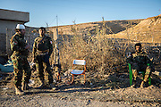 Kurdish Peshmerga soldiers relax at a checkpoint in the Yazidi town of Bashiqa. Bashiqa, Iraq. Nov. 20, 2016. (Photo by Gabriel Romero ©2016)