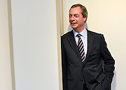© Licensed to London News Pictures. 23/03/2013. Exeter, UK . Nigel Farage, Leader of UKIP, poses for photographs. The UK Independence Party (UKIP) 2013 Spring Conference is held at the Great Hall, Exeter University today, Saturday 23rd March 2013. Support for the party is rising after success in the recent Eastleigh by-election, where UKIP came second behind the Liberal Democrats. Photo credit : Stephen Simpson/LNP