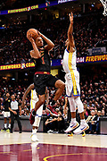 Jun 8, 2018; Cleveland, OH, USA; Cleveland Cavaliers guard Rodney Hood (1) shoots the ball against Golden State Warriors forward Andre Iguodala (9) during the fourth quarter in game four of the 2018 NBA Finals at Quicken Loans Arena.