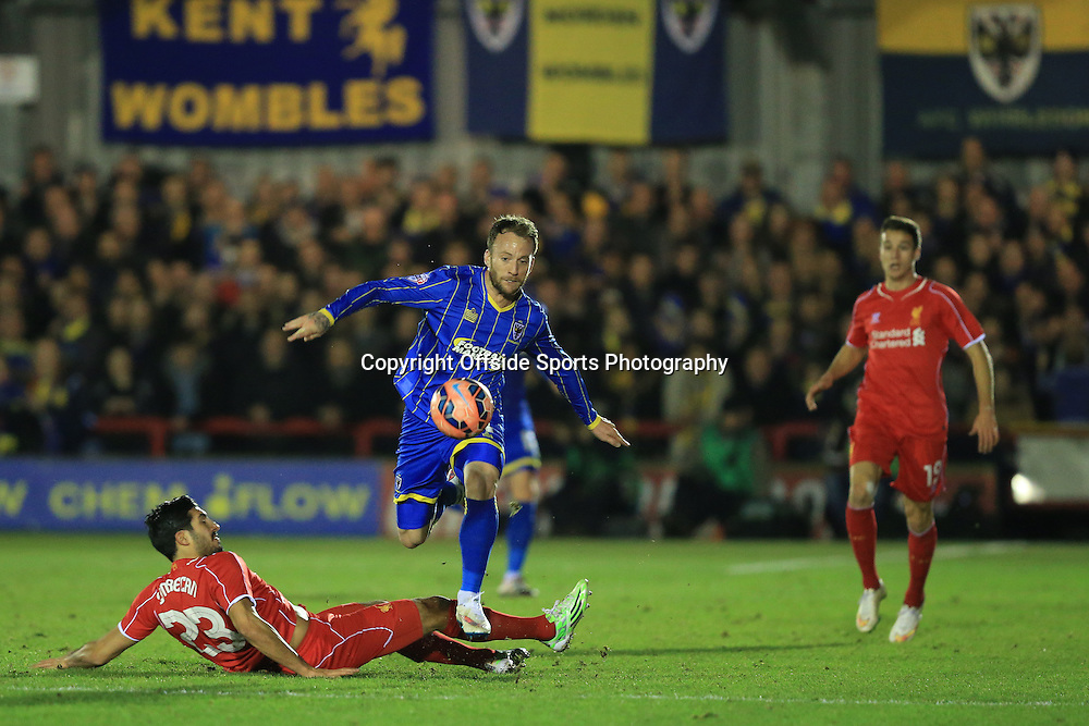 5 January 2015 - The FA Cup 3rd Round - AFC Wimbledon v Liverpool - Sean Rigg of AFC Wimbledon leaps over a tackle from Emre Can of Liverpool - Photo: Marc Atkins / Offside.