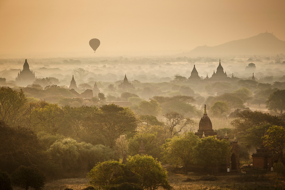 Sunrise and balloons over the misty plains and temples of Bagan in central Burma is one of the world's greatest archeological sites, a sight to rival Machu Picchu or Angkor Wat but – for the time being at least – without the visitors. The setting is sublime – a verdant 26 square-mile plain, part-covered in stands of palm and tamarind caught in a bend of the lazy-flowing Irrawaddy (Ayeyarwady) river and framed by the hazy silver-grey of distant mountains.
