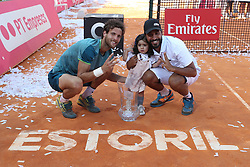 May 6, 2018 - Estoril, Portugal - Joao Sousa of Portugal and his Coach Frederico Marques (R ) pose with the trophy after winning the Millennium Estoril Open ATP 250 tennis tournament final against Frances Tiafoe of US, at the Clube de Tenis do Estoril in Estoril, Portugal on May 6, 2018. (Joao Sousa won 2-0) (Credit Image: © Pedro Fiuza/NurPhoto via ZUMA Press)